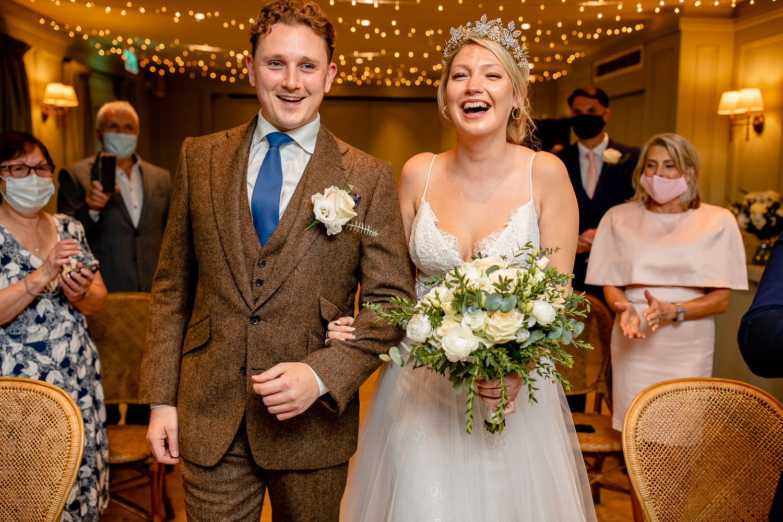 Bride and Groom entering the wedding ceremony room.