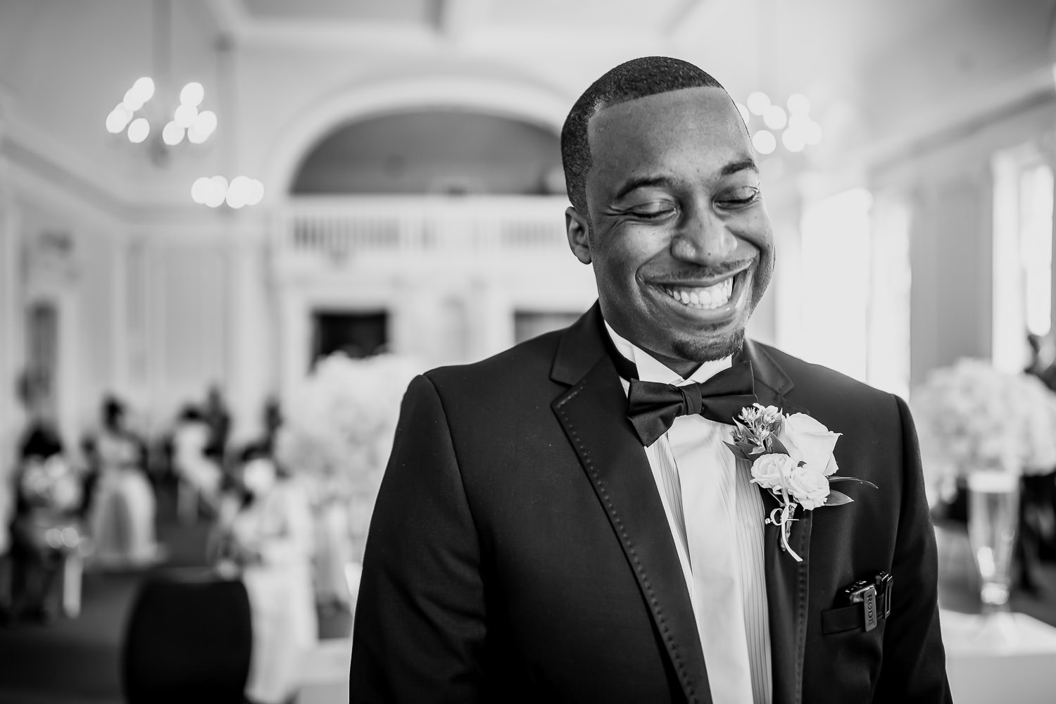 The Groom with the biggest of smiles as he waits for his Bride at the end of the aisle.