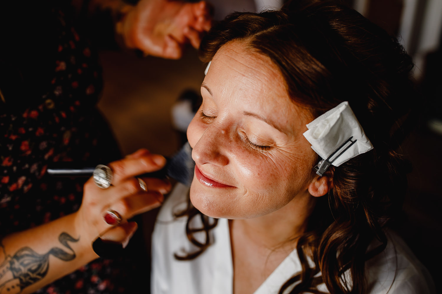Bride has her makeup done in the morning.