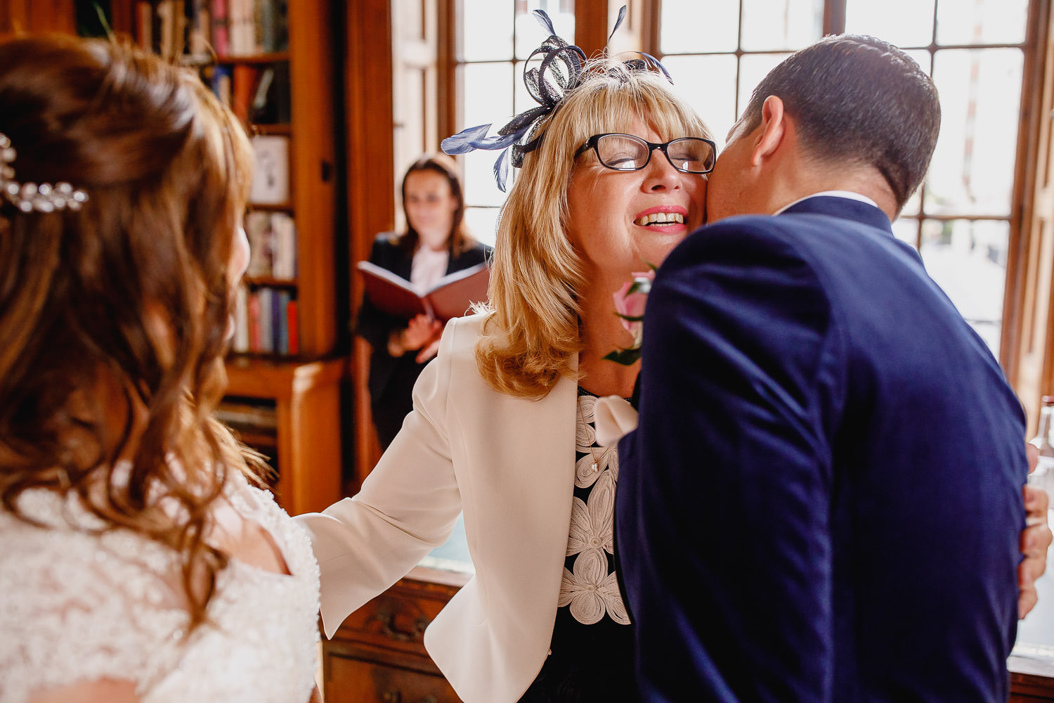Bridegroom kisses his mother on wedding day.