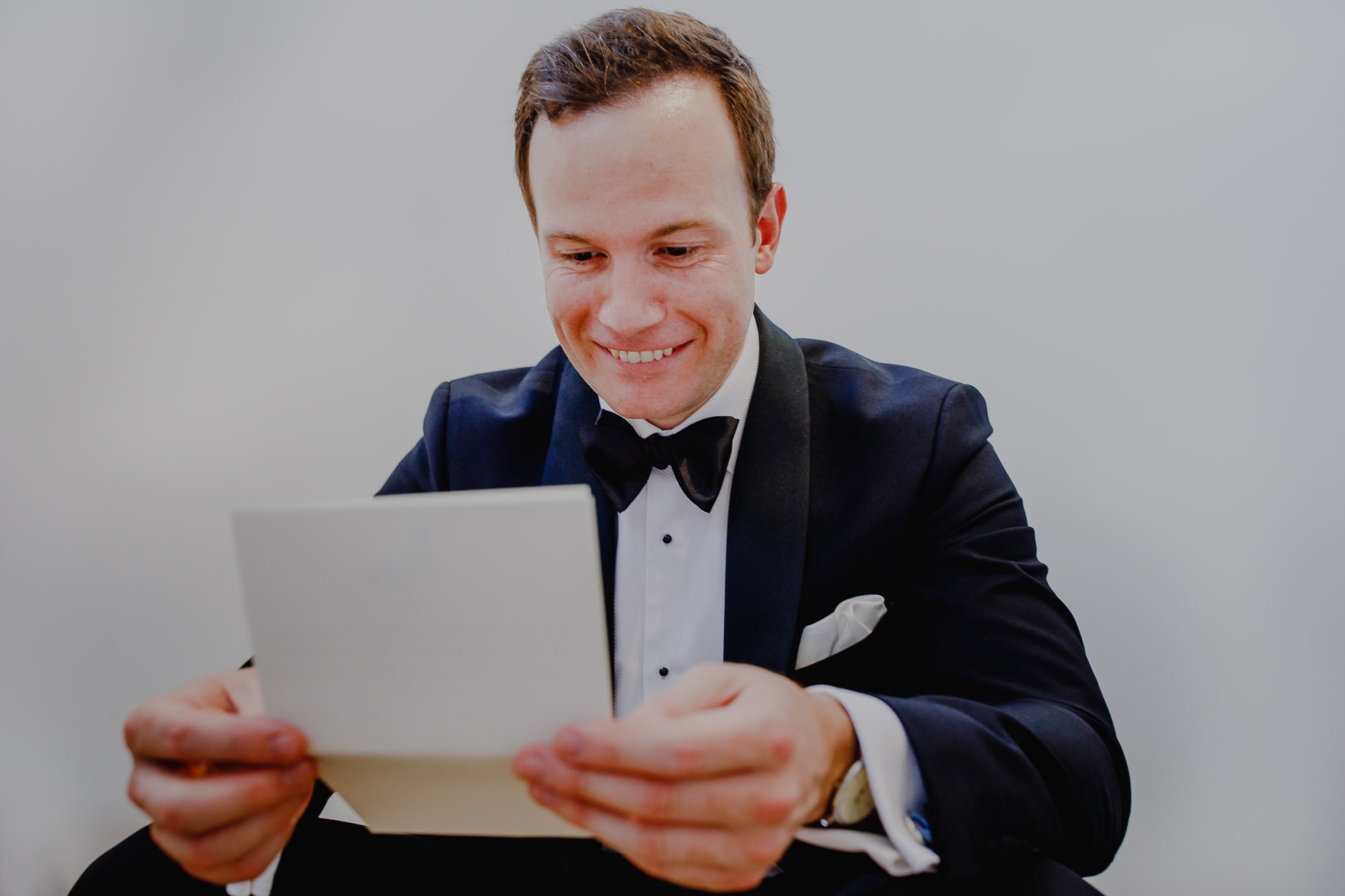 Groom read letter from his bride.